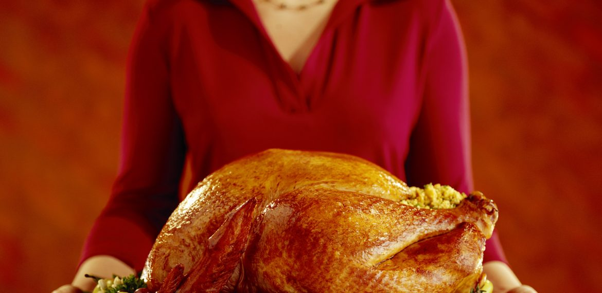 Woman with roast turkey
